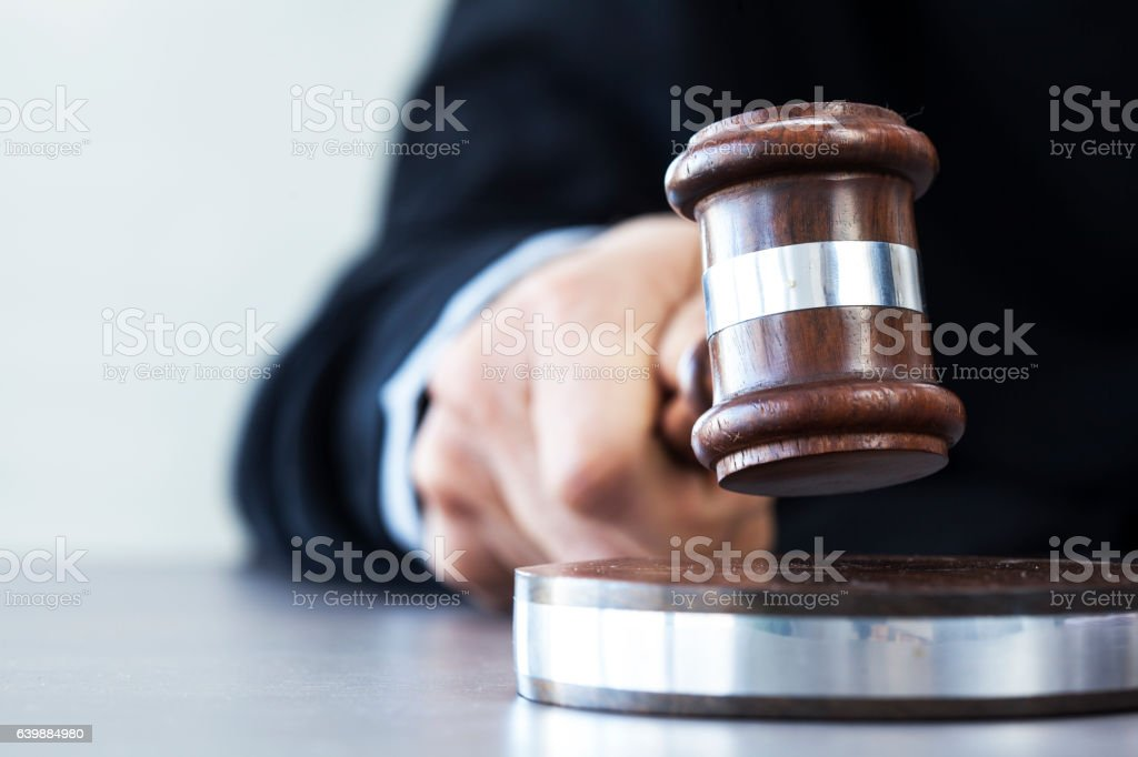 Judge with gavel on table stock photo