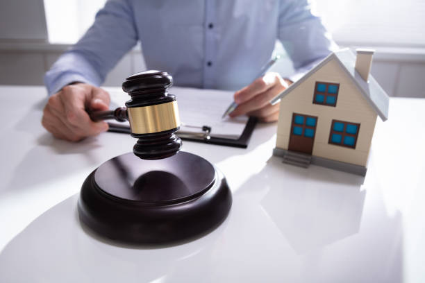 judge with house model hitting gavel - real estate law stock photos and pictures
