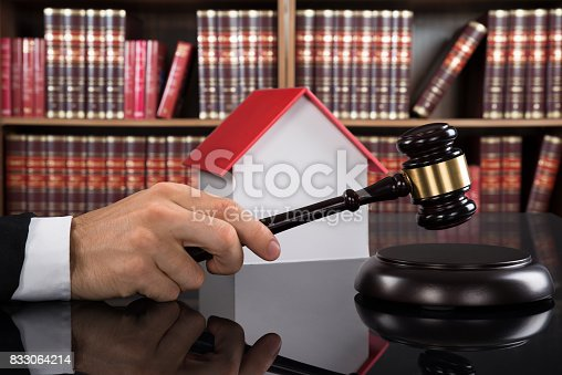 istock Judge With House Model Hitting Gavel 833064214