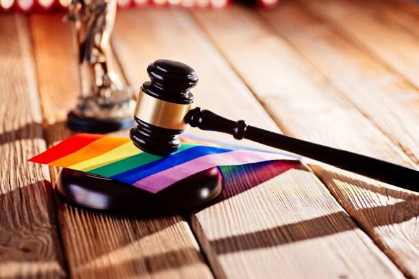 Judge wooden mallet - symbol of law and justice with lgbt rainbow colours flag Judge wooden mallet - symbol of law and justice with lgbt rainbow colours flag. Lgbt rights and law lgbtqi rights stock pictures, royalty-free photos & images
