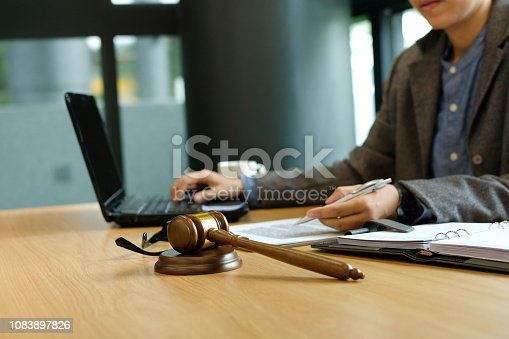 istock judge work with document computer. legal law gavel at courtroom. lawyer attorney justice at court 1083897826