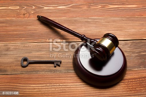 istock Judges Auctioneer Gavel, Retro Door Key On The Wood Table 515231498
