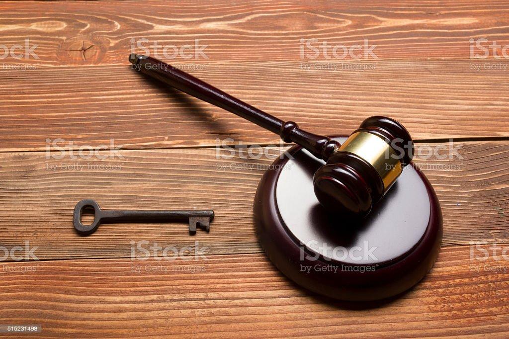 Judges Auctioneer Gavel, Retro Door Key On The Wood Table stock photo