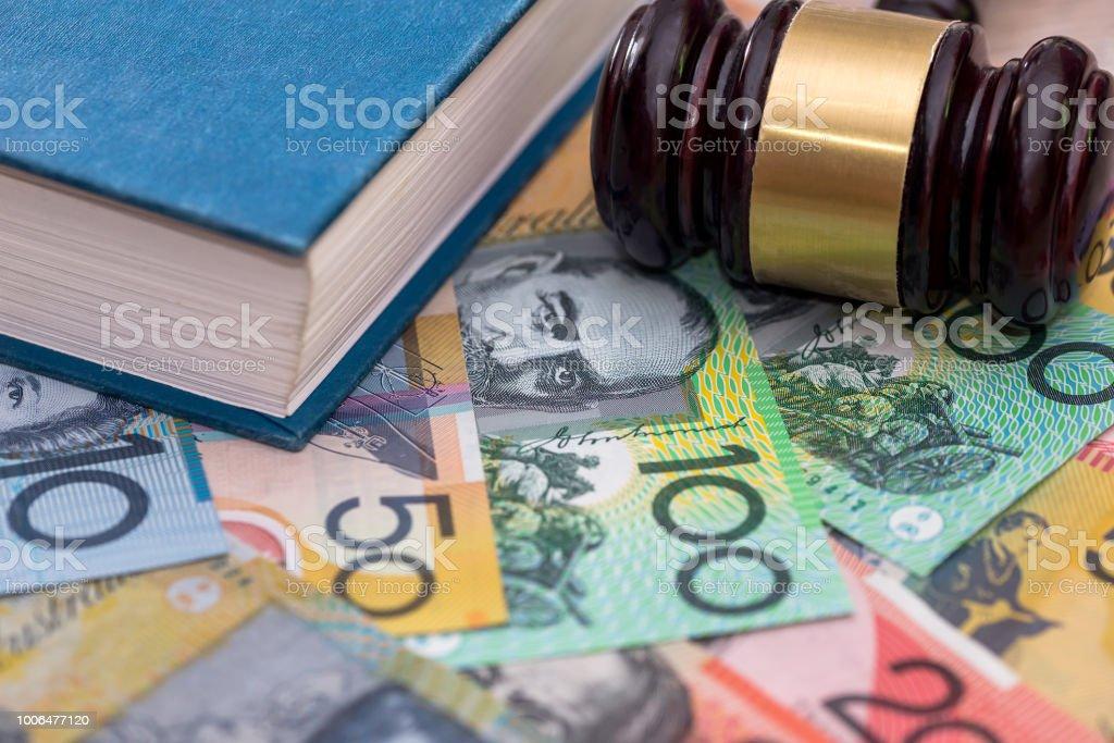 Judge's gavel and book on australian dollar background stock photo