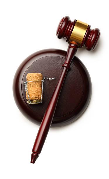 Judge's gavel and cork stock photo