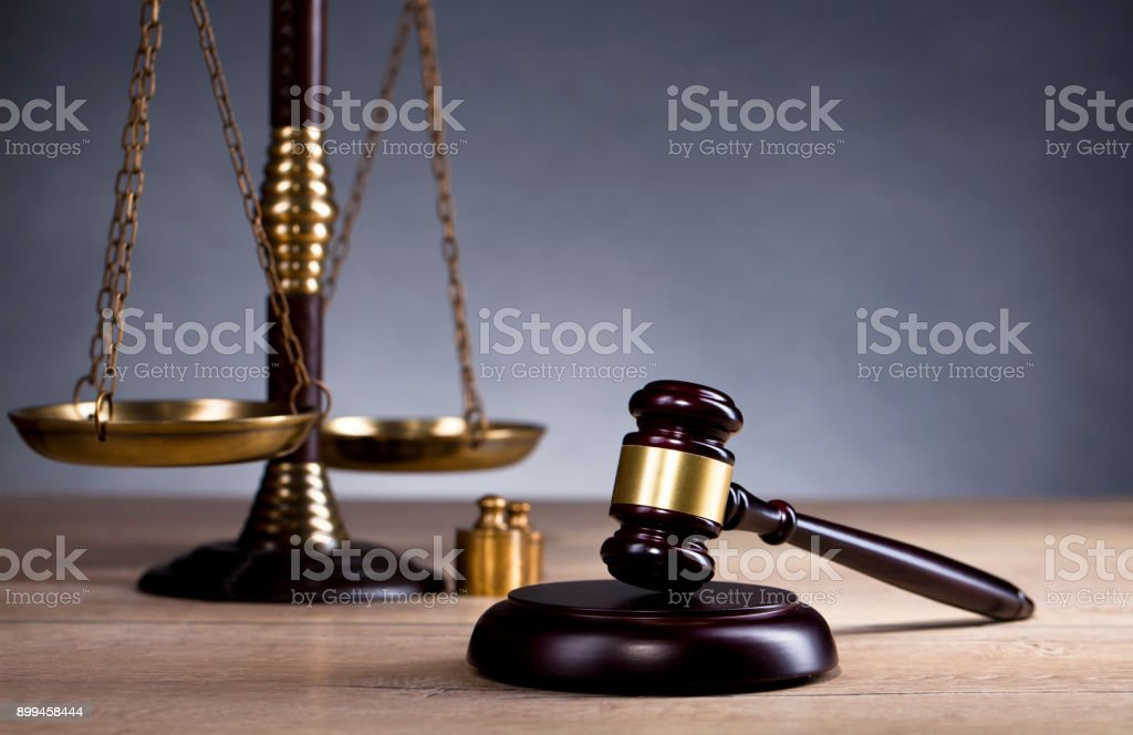 Judge`s gavel and golden scales of justice. Law concept stock photo