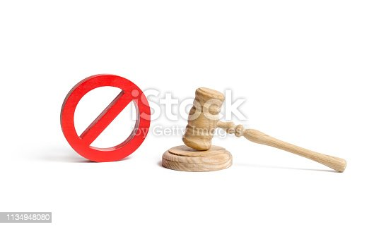 istock Judge's gavel and NO symbol on an isolated background. The concept of prohibiting and restrictive laws. Prohibitions and criminalization, repression, restriction of freedoms and rights of people 1134948080