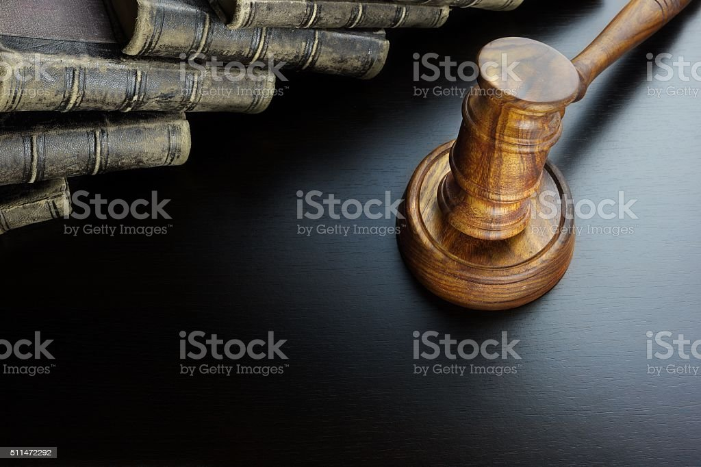 Judges Gavel And Old Book  On The Black Wooden Table stock photo