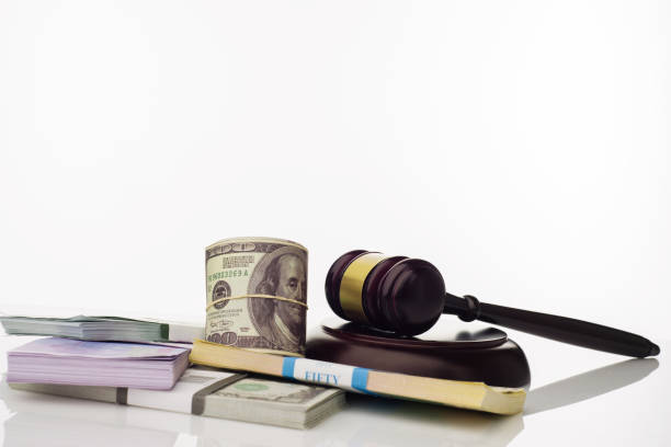 Judge's gavel and packs of dollars and euro banknotes on a white background Judge's gavel and packs of dollars and euro banknotes on a white background. The concept of growing national debt- image sanctions stock pictures, royalty-free photos & images