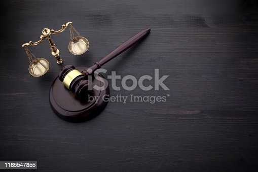 Judges Gavel And Scale Of Justice On The Black Background. Law Concept.