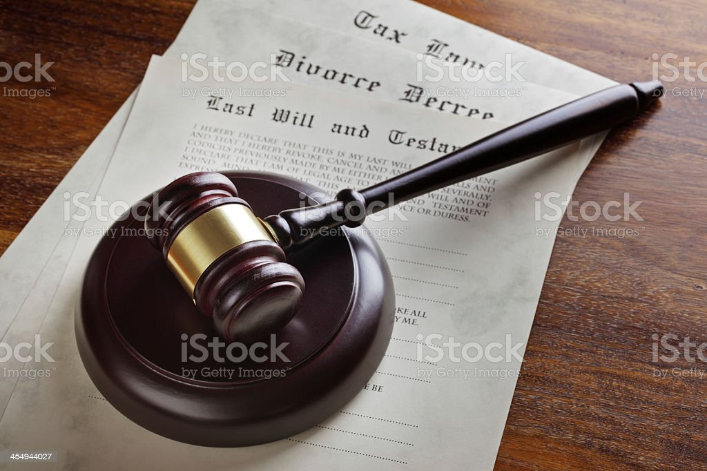 Judge's gavel atop a stack of court documents stock photo