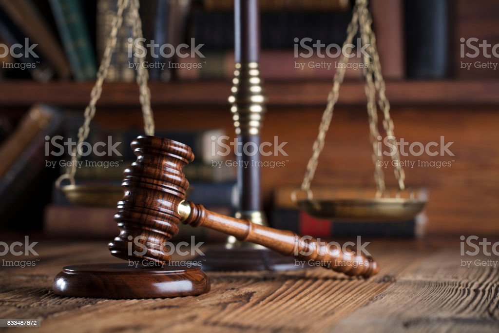 Judges gavel. Books. Wooden table stock photo