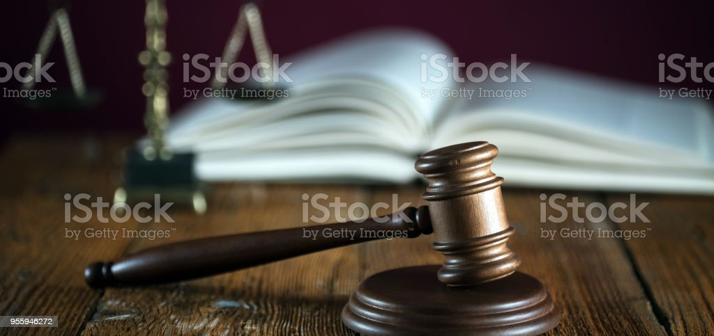 Judge's gavel in courtroom library. Law concept. stock photo
