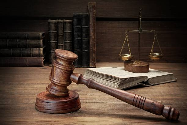 Judges Gavel, Legal Code And Scales Of Justice Closeup stock photo