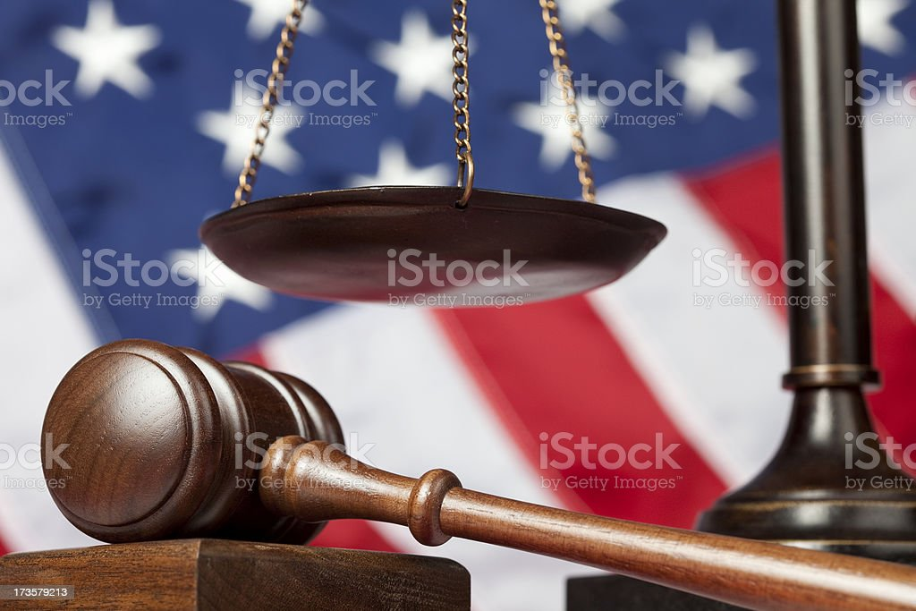 Judge's gavel next to scale of justice royalty-free stock photo