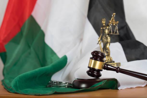 judge's gavel on a flag of the united arab emirates. - sharia foto e immagini stock