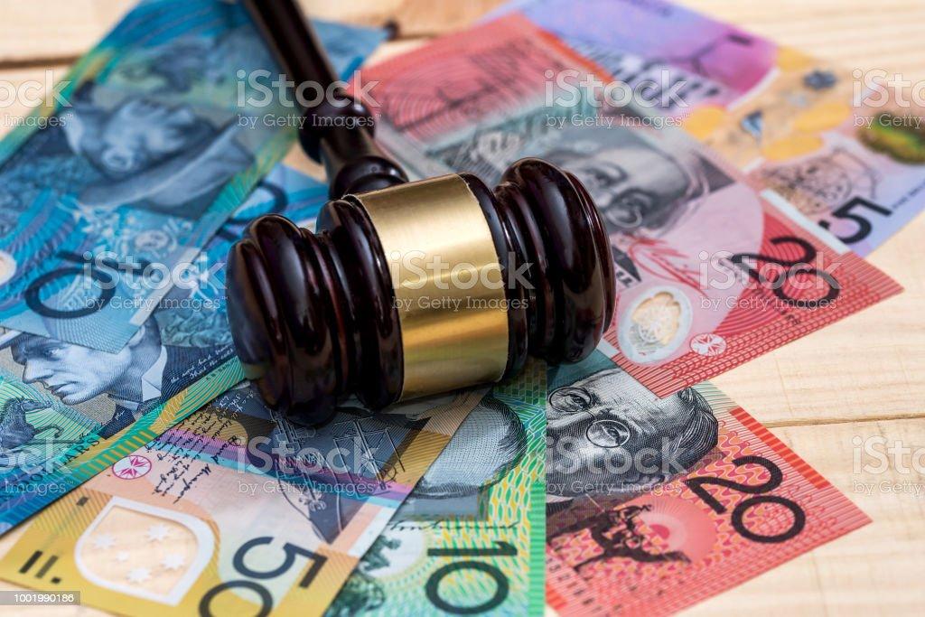 Judge's gavel on australian dollar banknotes, closeup stock photo