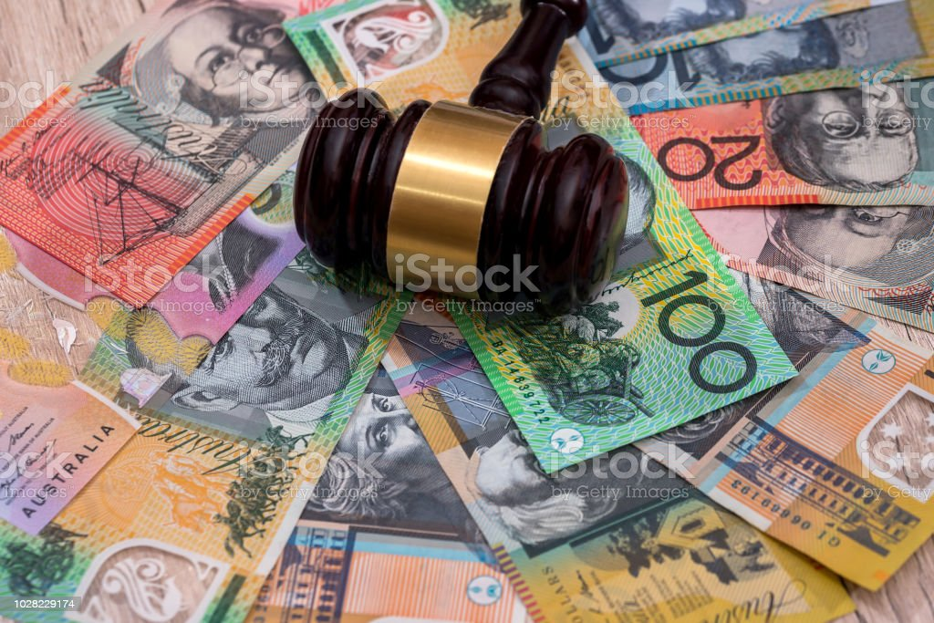 Judge's gavel on australian dollars, justice concept stock photo