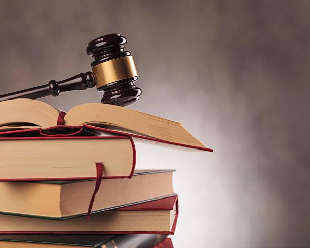 judge's gavel on top  of books with copyspace - bücherbund stock-fotos und bilder