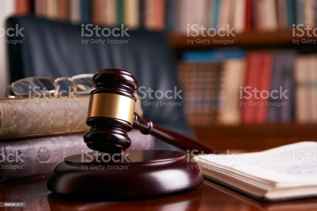 Judge's Gavel or mallet on wooden table stock photo