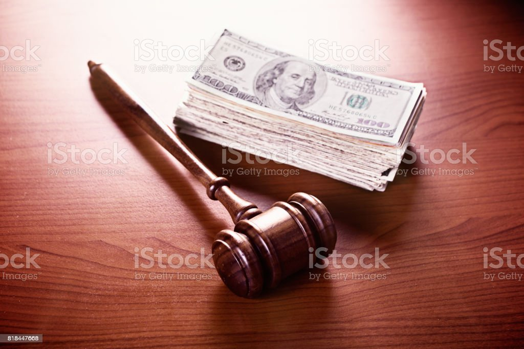 Judge's gavel with large cash stash stock photo