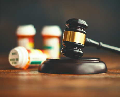Judge's gavel with medications. Medical malpractice