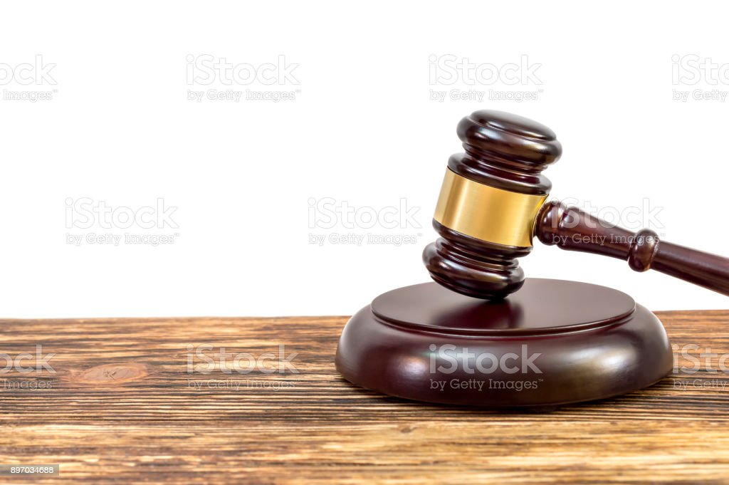 Judge's gavel with stand on the table. Isolated on white. stock photo