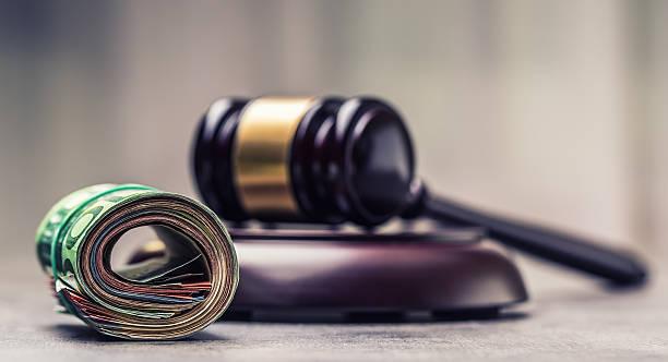 judge's hammer gavel. justice and euro money. - wirtschaftsrecht stock-fotos und bilder