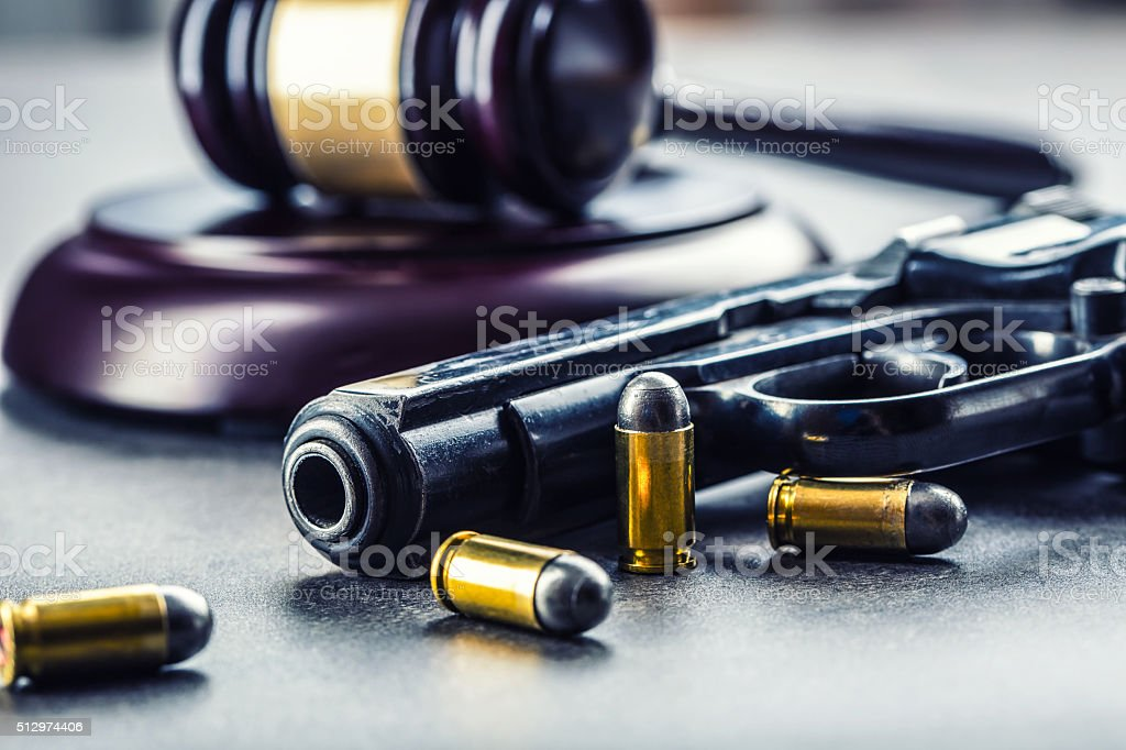 Judge's hammer gavel. Justice and gun. Justice and the judiciary stock photo