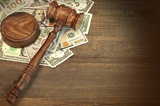 Judges or Auctioneer Gavel And Money On The Wooden Table Concept For Corruption, Bankruptcy Court, Bail, Crime, Bribing, Fraud, Auction Bidding. Judges or Auctioneer Gavel, Soundboard And Bundle Of Dollar Cash On The Rough Wooden Textured Table Background. lawsuit stock pictures, royalty-free photos & images
