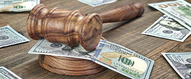 Judges or Auctioneers Gavel And Money Stack On Wooden Background stock photo