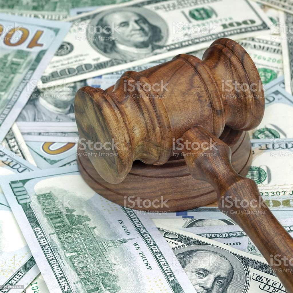 Judges or Auctioneers Hammer On Huge Money Heap stock photo