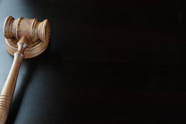 Judges Or Auctioneers Walnut Gavel On The Black Table stock photo