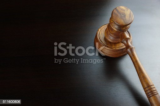 istock Judges Or Auctioneers Walnut Gavel On The Black Table 511600806