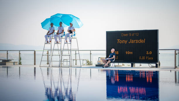 judges sitting on chairs near swimming pool - judge sports official stock photos and pictures