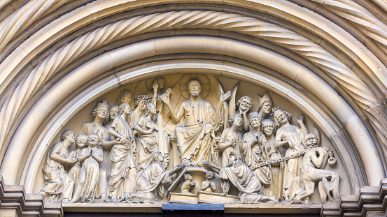 Judgment Day scene on top of the Fürstenportal of Bamberg cathedral (Bavaria / Germany).