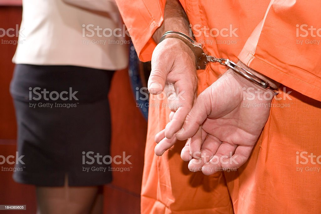 US Judicial System-handcuffed hands royalty-free stock photo