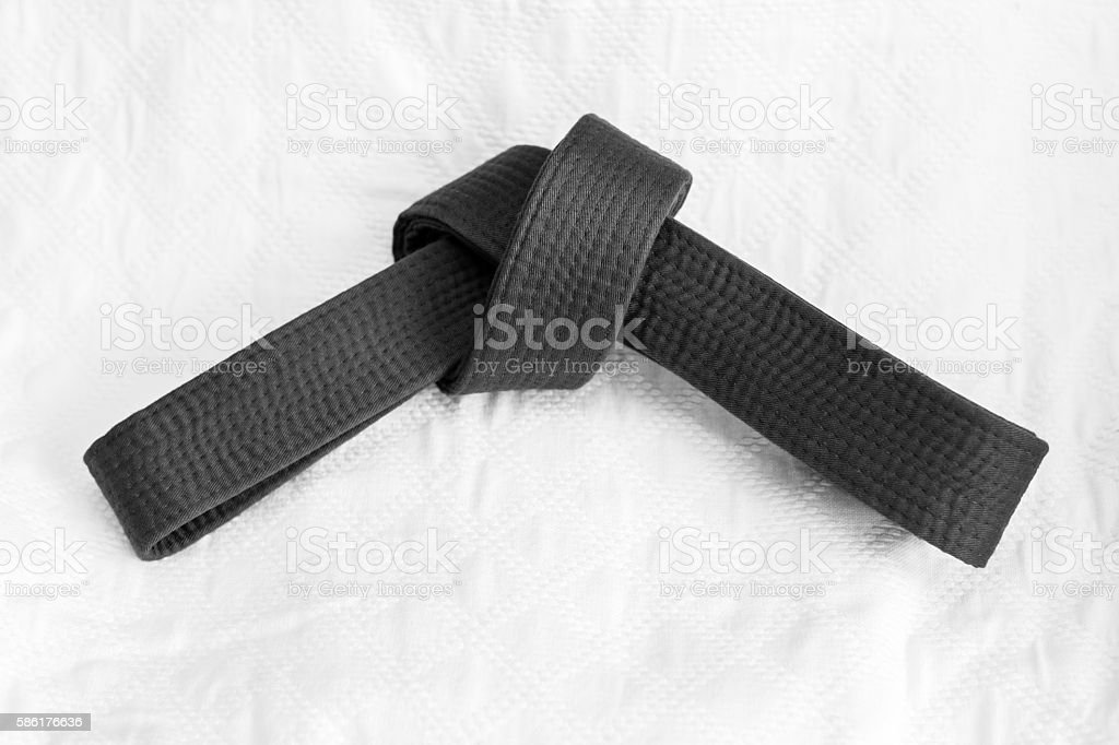 Judo belt on white kimono stock photo