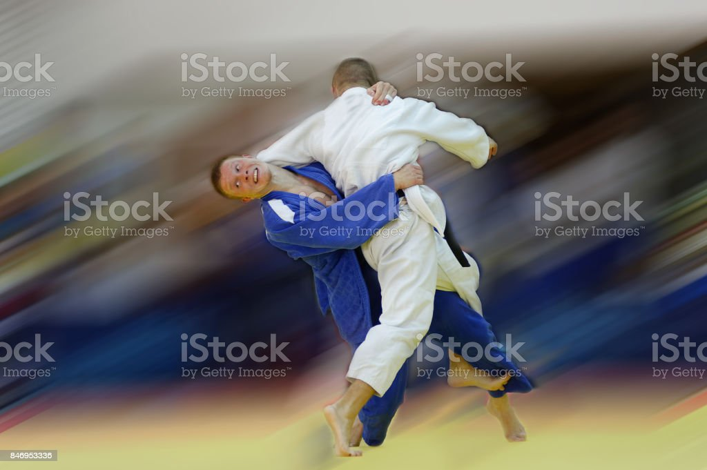 Judo counter throw with motion blur stock photo