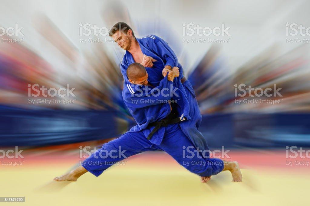 Judoka attempting Tai Otoshi throw with full commitment stock photo