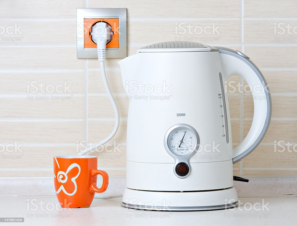 jug kettle water drink warmer and cup stock photo