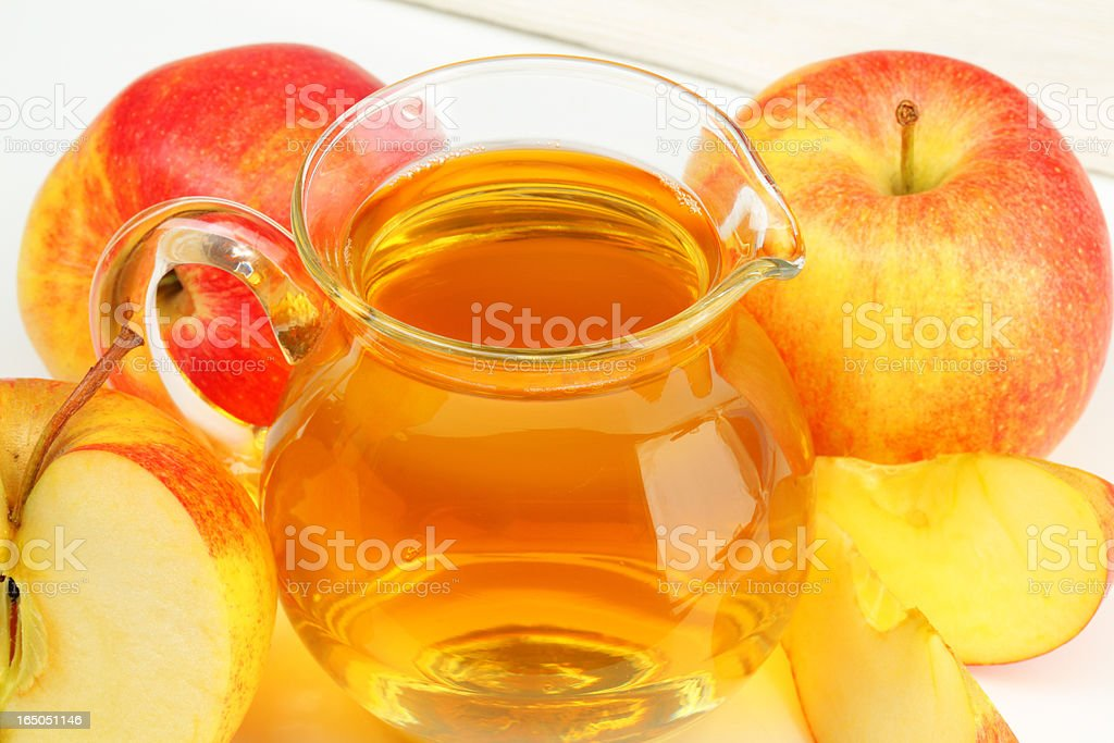jug of apple cider and apples royalty-free stock photo