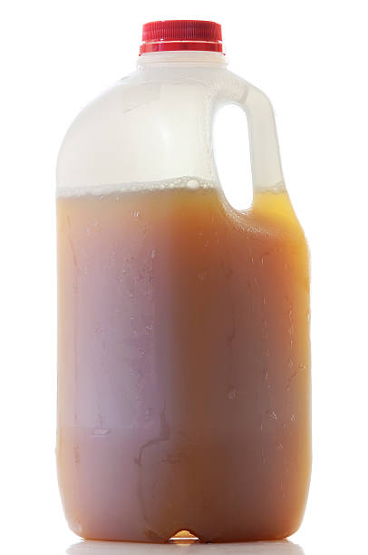 Jug of Apple Cider A single plastic jug of Apple Cider isolated on white. hot apple cider stock pictures, royalty-free photos & images