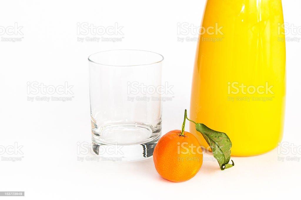 Jug of juice, glass and an orange stock photo