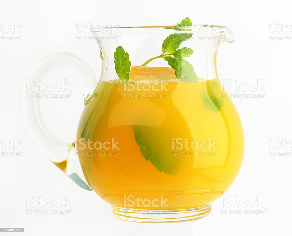 jug of orange juice with ice and mint royalty-free stock photo