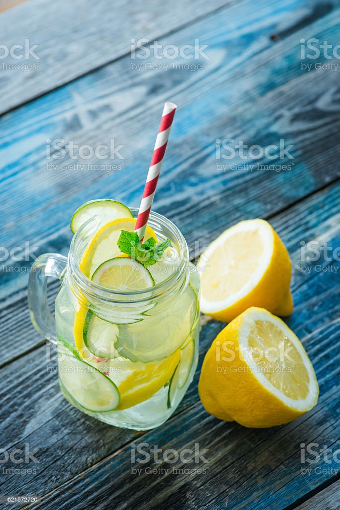 Jug with lemon and lime infused water photo libre de droits