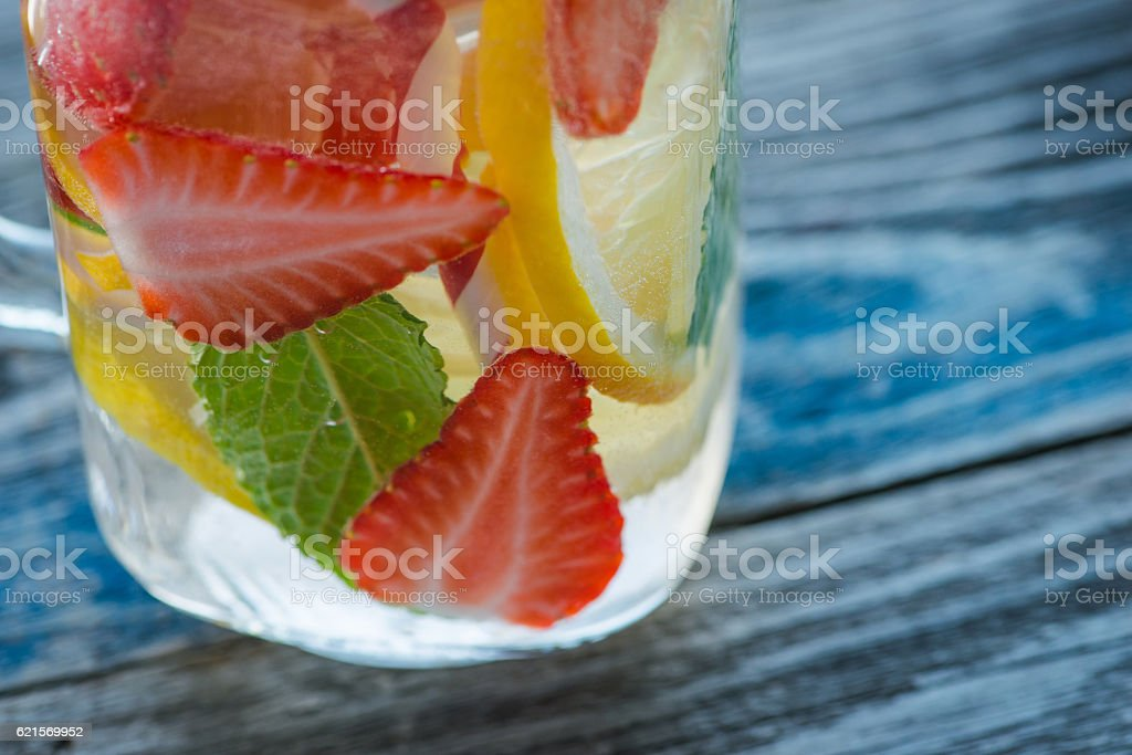 Jug with lemon and strawberry infused water foto stock royalty-free