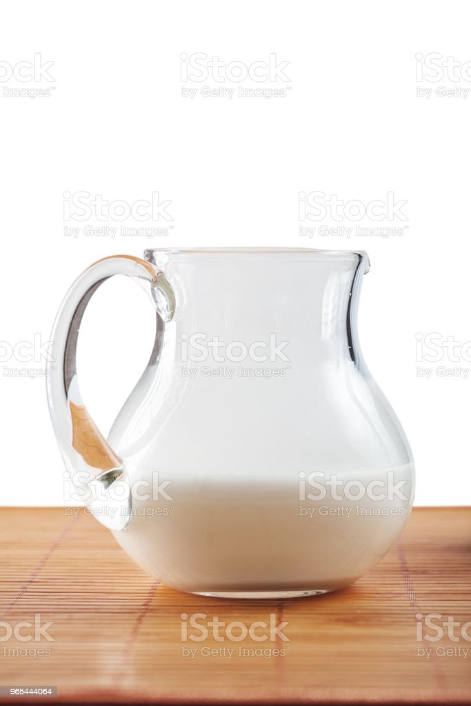 jug with milk on table isolated royalty-free stock photo