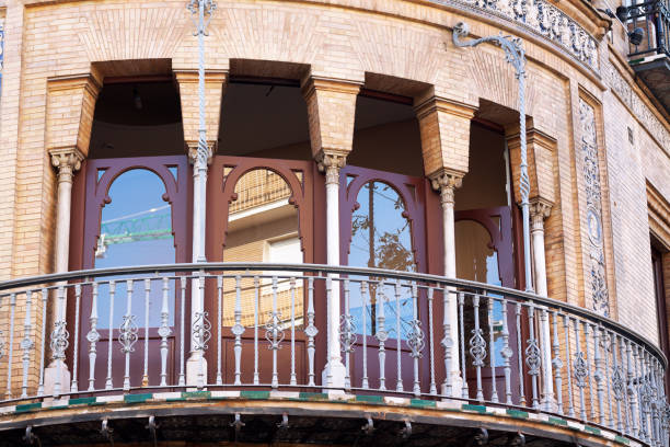 jugenstil balcony in sevilla - art nouveau stock photos and pictures