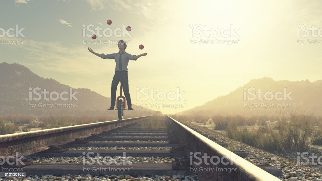 Juggler is balancing on railroad stock photo